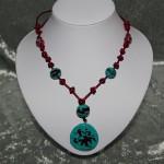 Collier  noeud chinois perles médaillon céramique   23€